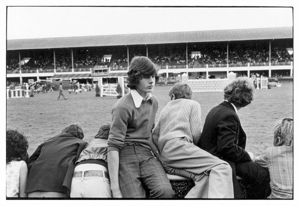 William Gedney, Boys leaning over and sitting on fence at races, Ballsbridge, 1974